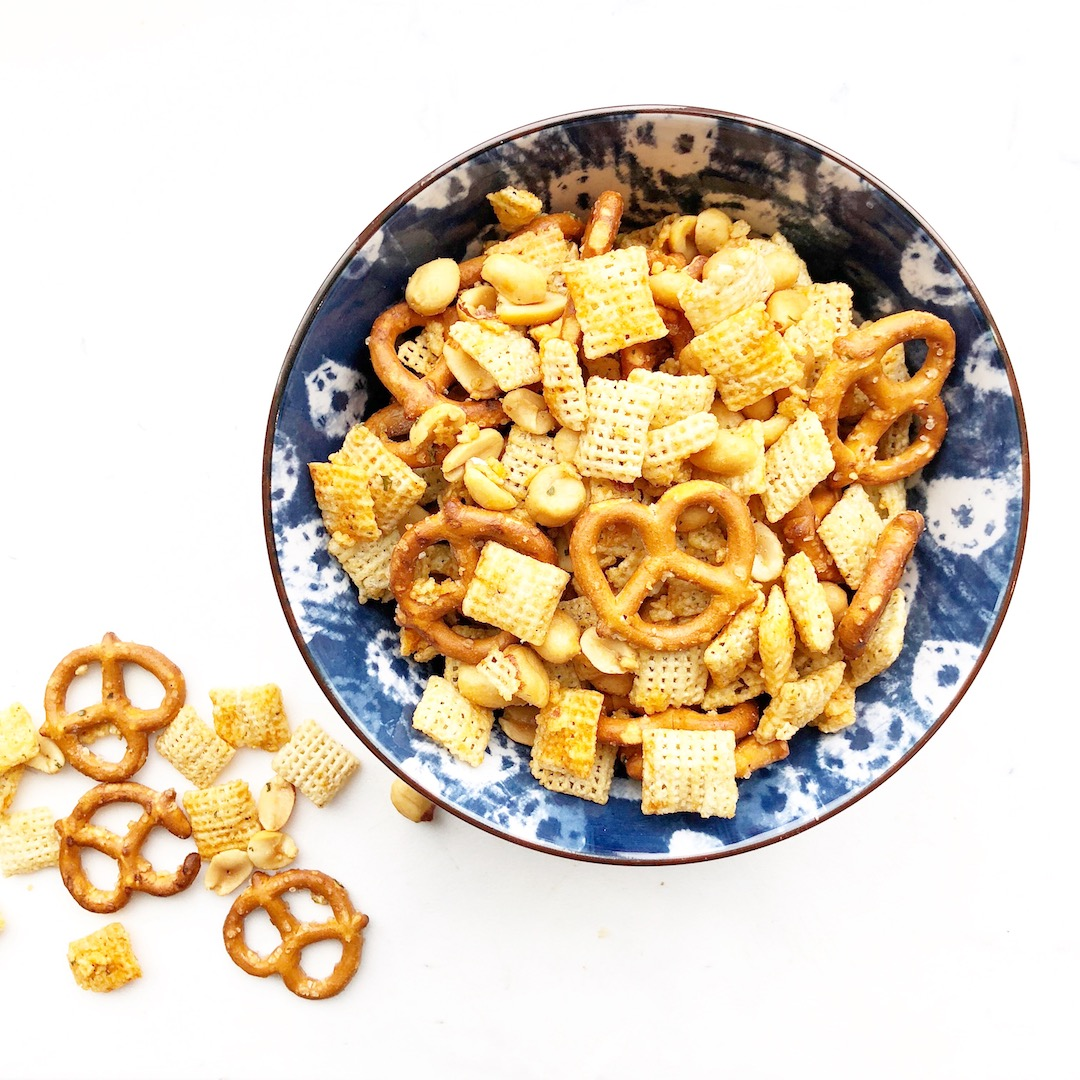 buffalo chex mix in a blue bowl
