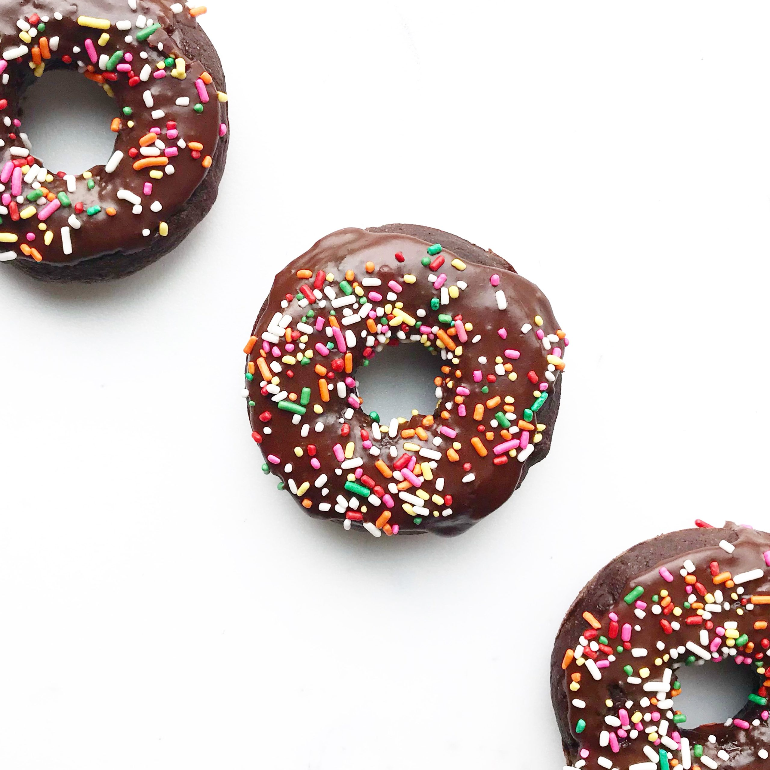 rainbow sprinkle baked chocolate donuts
