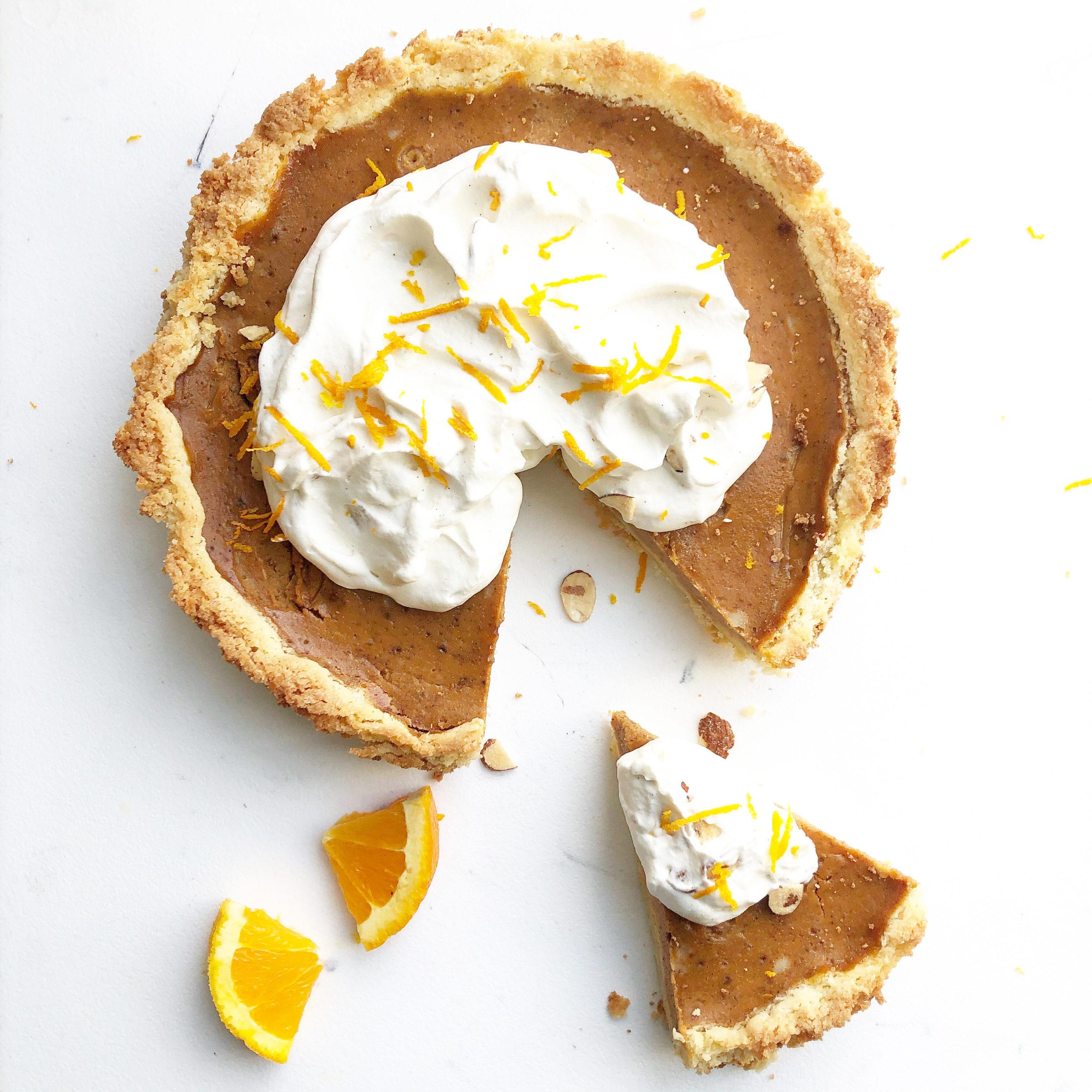 Orange Maple Pumpkin Pie on a white background