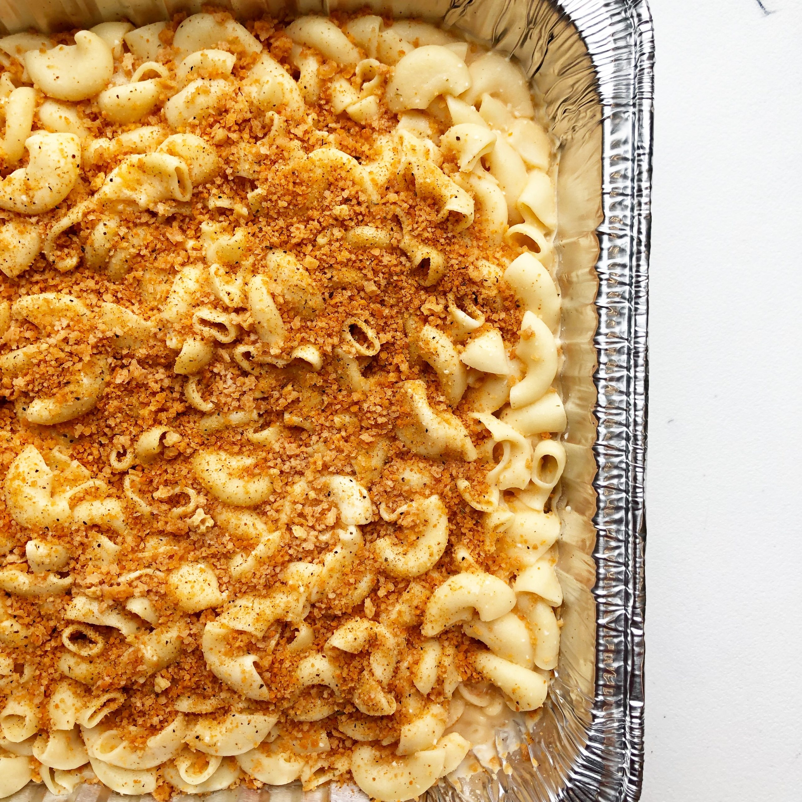 macaroni and cheese in a foil tray