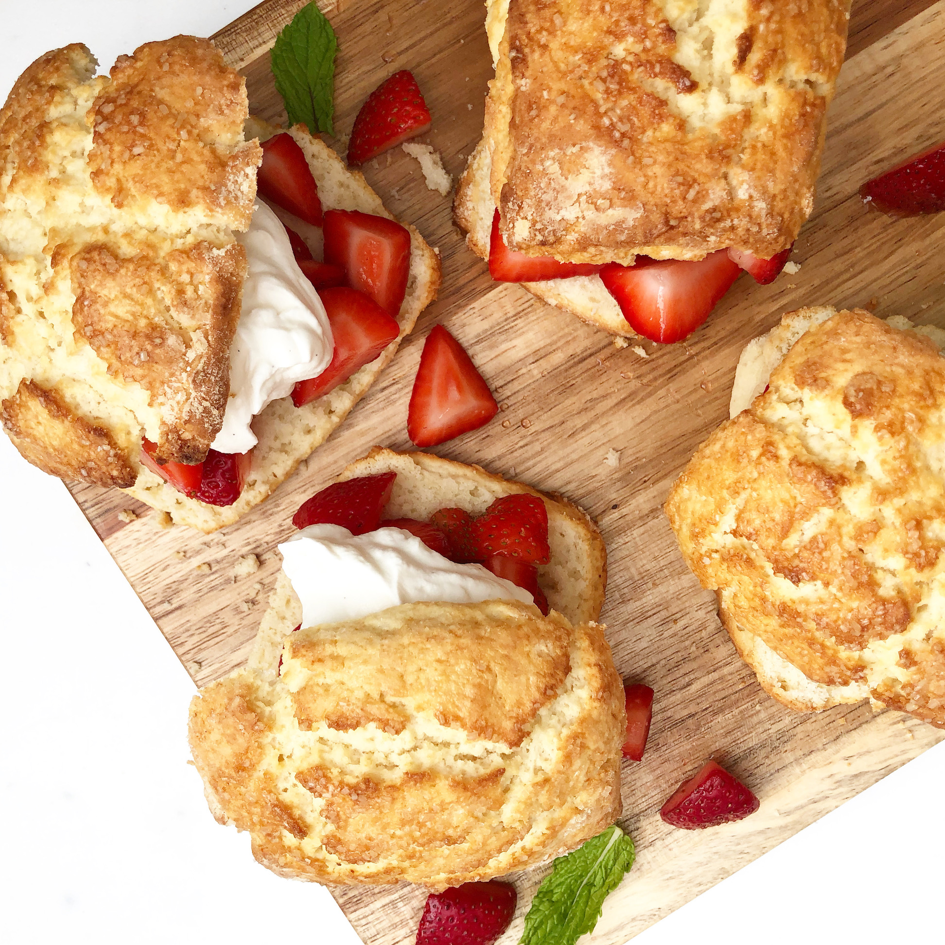 strawberry shortcakes on a wooden board