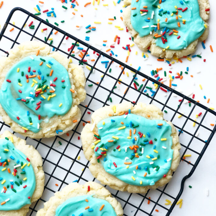 frosted sugar cookies with sprinkles