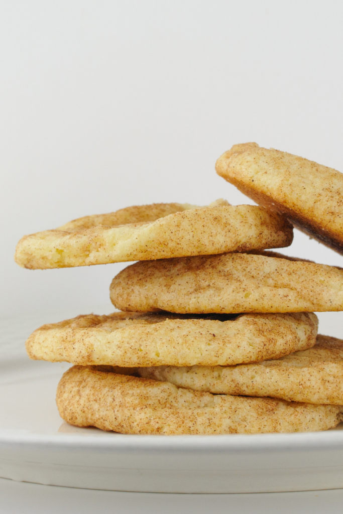 Snickerdoodle cookies stacked on a plate