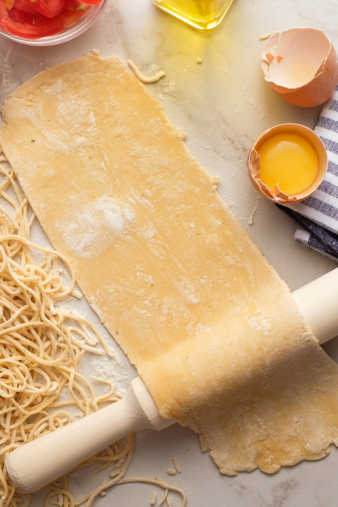 homemade pasta on a rolling pin