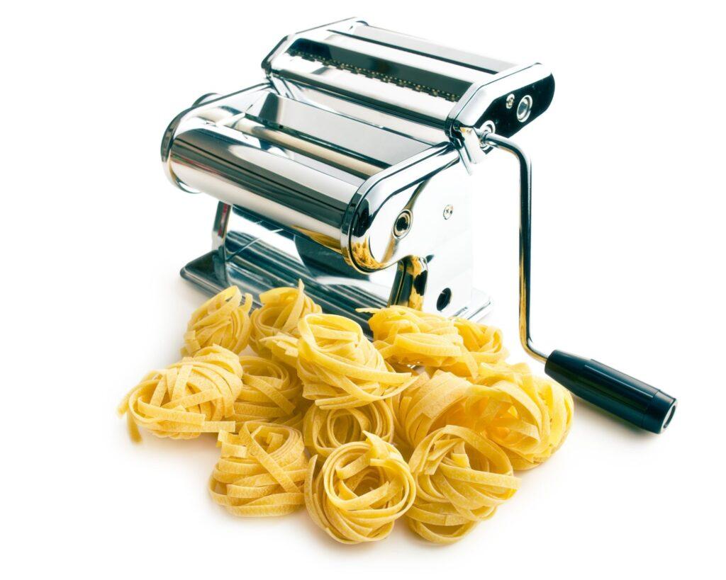 hand cranked pasta machine with fresh pasta