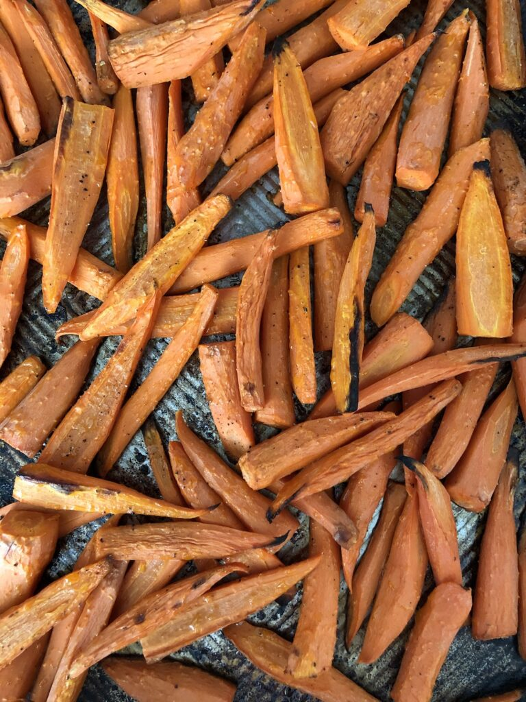 roasted carrots on a baking sheet