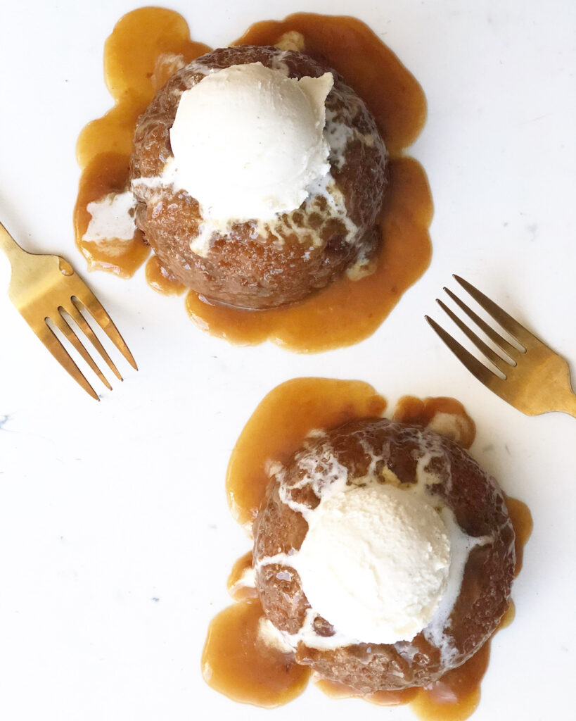 sticky toffee pudding with two forks