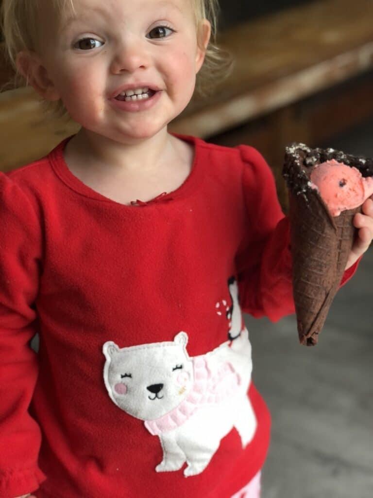 child holding ice cream cone